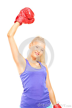 Young female boxer gesturing victory