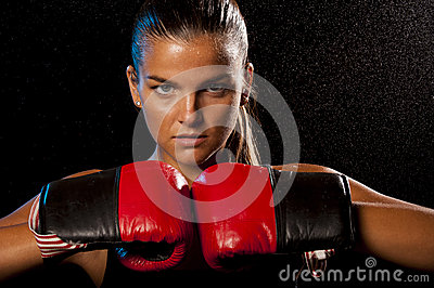 Young Female boxer in water drops
