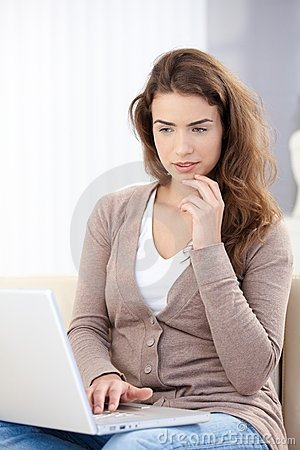 Young female browsing internet at home