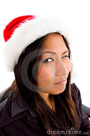 Young female in christmas hat winking