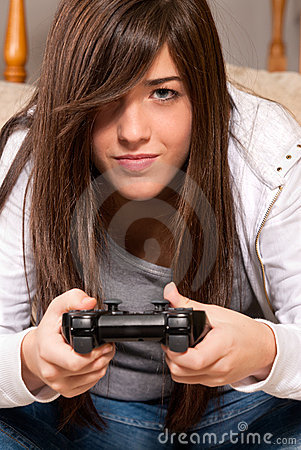 Young female concentrating playing video-games