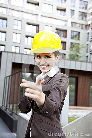 Young female construction engineer pointing