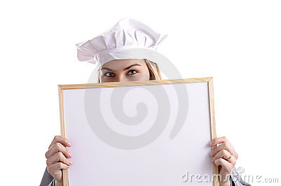 Young female cook hiding behind an add panel