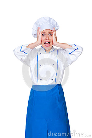 Young female cook in panic
