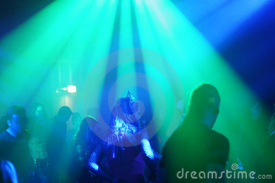 Young female dancer in/between beams of light