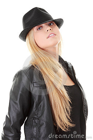 Young female dancer in black hat