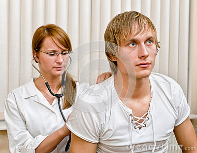 Young female doctor examine male patient