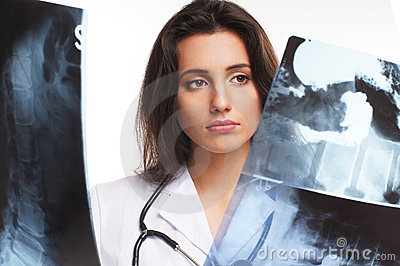 A young female doctor is examining the x-rays