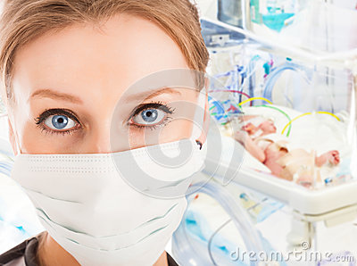Young female doctor in ICU with newborn child