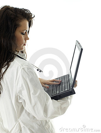 Young female doctor keeping laptop