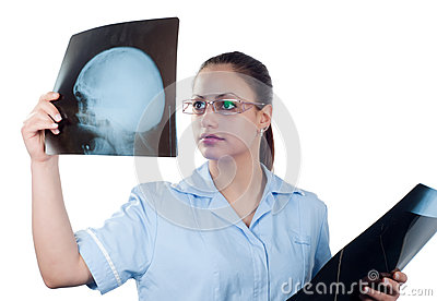 Young female doctor looking at x-ray picture