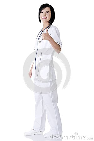 Young female doctor or nurse gesturing OK