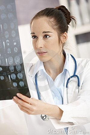 Young female doctor in office