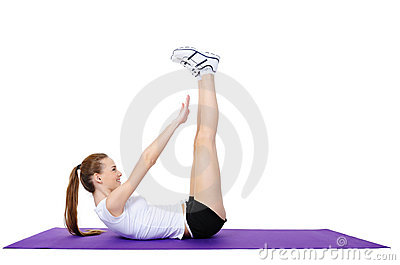 Young female doing physical exercises on the floor