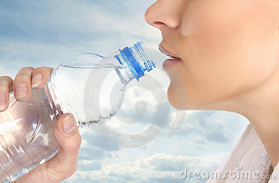 A young female is drinking refreshing water