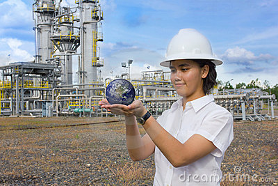 Young female engineer holding earth sphere.