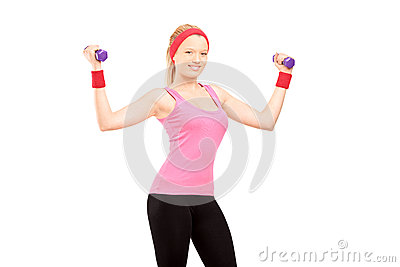 Young female excercising with dumbbells