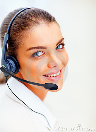 A young female executive communicating on headset