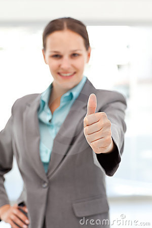 Young female executive doing a thumbs up