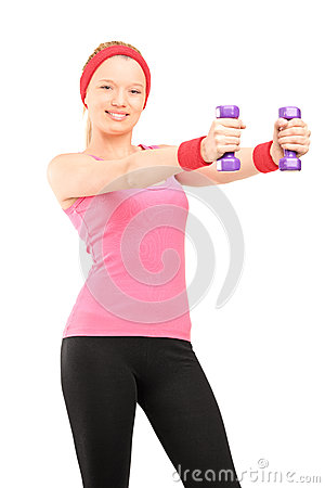 Young female exercising with dumbbells