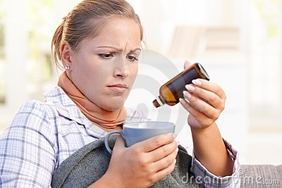 Young female feeling bad taking vitamin