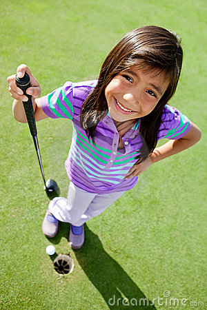 Young female golf player