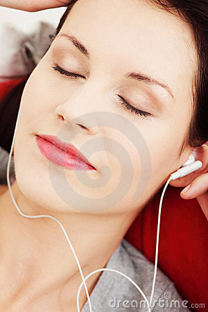 Young female with headphones listening music