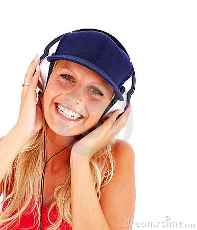Young female hearing music on the headphones