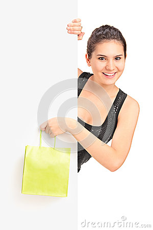 Young female holding bag and panel