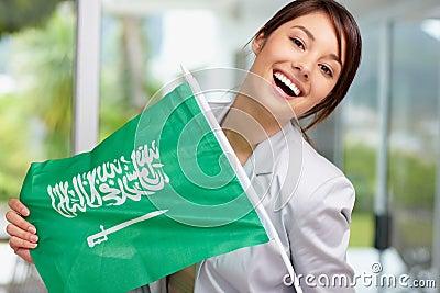 Young female holding a Saudi Arabian flag
