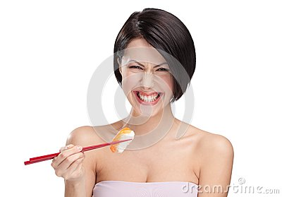 Young female holding sushi with a chopsticks