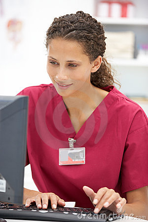 Young female hospital doctor at desk
