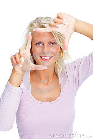 Young female making a frame with hands on white