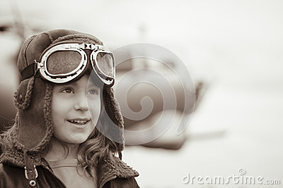 Young female pilot looking into distance