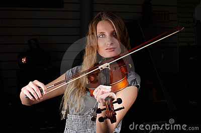 Young female play on violin