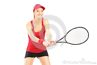 A young female playing tennis