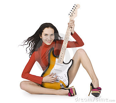 Young female posing with guitar over white