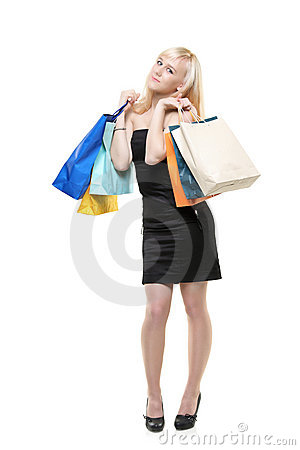 A young female posing with shopping bags