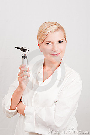 Young female professional doctor with medical tool