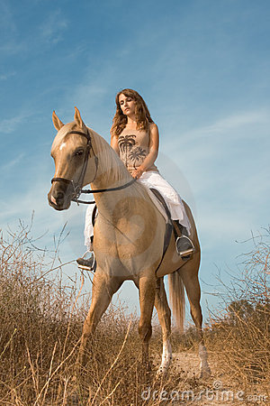 Young female riding on horse