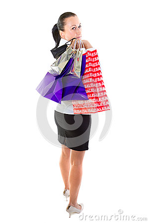 Young female with shopping bags over white