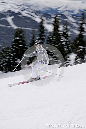 A young female skier enjoying downhill skiing in British Columbi