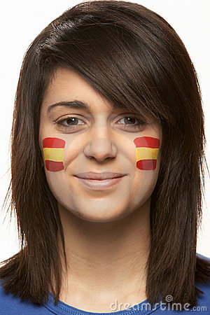 Young Female Sports Fan With Spanish Flag Painted