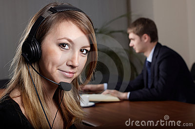 Young female talk by  headset
