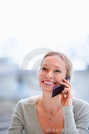 A young female talking on the phone