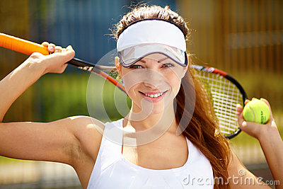Young female tennis player holding a ball and racq