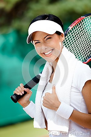 Young female tennis player with towel