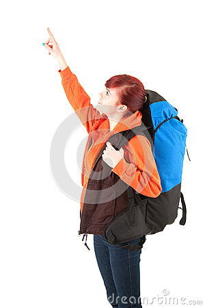 Young female tourist with backpack pointing up