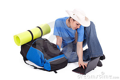 Young female tourist with laptop