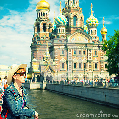 Young female tourist near the Church of Savior on Spilled Blood